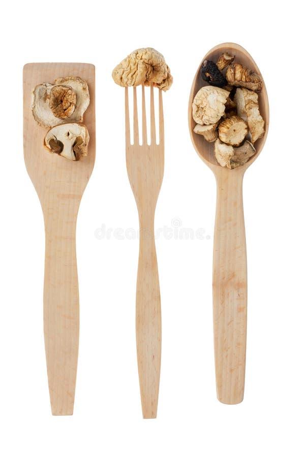 Ξύλινο κουτάλι, δίκρανο, κουπί με το μανιτάρι στοκ φωτογραφία