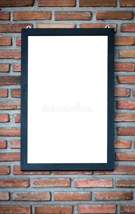 Ξύλινο πλαίσιο σε έναν τουβλότοιχο στοκ φωτογραφία