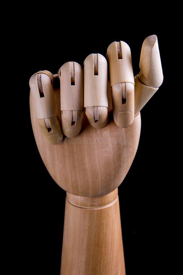 Ξύλινο χέρι σε ένα σκοτεινό υπόβαθρο στοκ φωτογραφίες