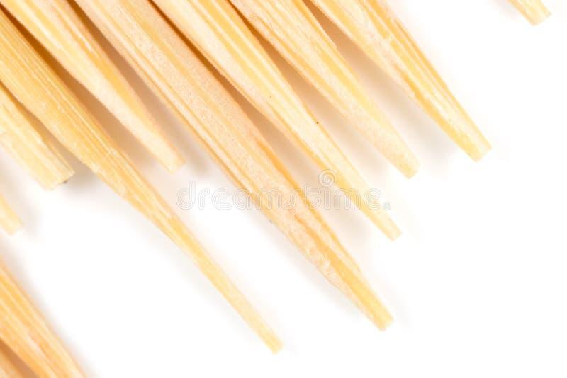 Οδοντογλυφίδα σε μια άσπρη ανασκόπηση Μακροεντολή στοκ φωτογραφίες με δικαίωμα ελεύθερης χρήσης