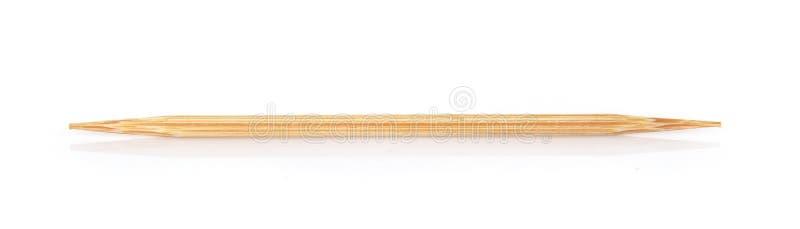 Οδοντογλυφίδα στο άσπρο υπόβαθρο στοκ φωτογραφία
