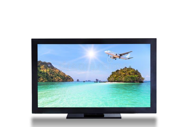 Οθόνη τηλεοπτικής TV με το αεροπλάνο που προσγειώνεται επάνω από το μικρό νησί στην μπλε εικόνα τοπίων θάλασσας στοκ φωτογραφία με δικαίωμα ελεύθερης χρήσης