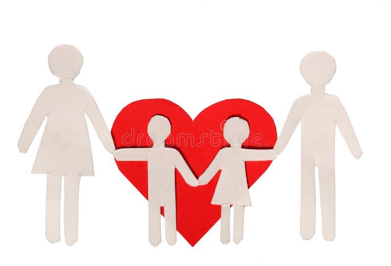 Οικογένεια εγγράφου και κόκκινη καρδιά που απομονώνονται στο λευκό. Αγάπη και οικογένεια στοκ εικόνα