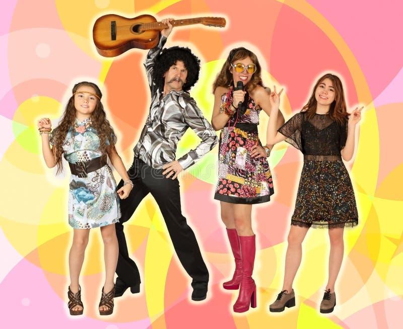 Οικογένεια Disco σε ένα ζωηρόχρωμο υπόβαθρο στοκ φωτογραφία με δικαίωμα ελεύθερης χρήσης