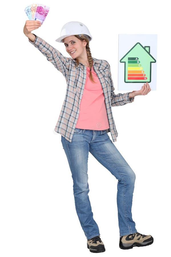 Οικοδόμος με ένα σημάδι ενεργειακής εκτίμησης στοκ εικόνα με δικαίωμα ελεύθερης χρήσης