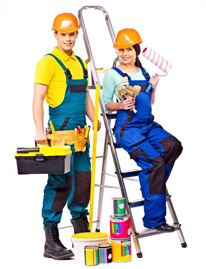 Οικοδόμος ζεύγους με τα εργαλεία κατασκευής. στοκ φωτογραφία