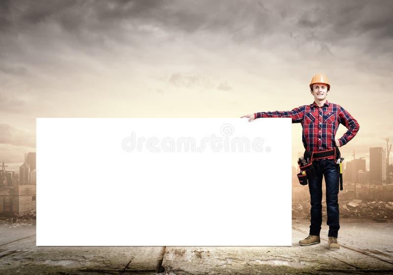 Οικοδόμος με το έμβλημα στοκ φωτογραφία