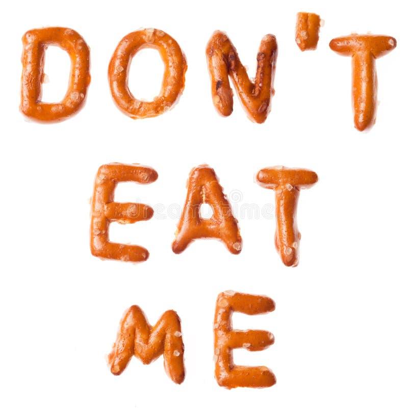 Οι γραπτές pretzel λέξεις αλφάβητου ΔΕΝ ΜΕ ΤΡΩΝΕ που απομονώνομαι στοκ εικόνες