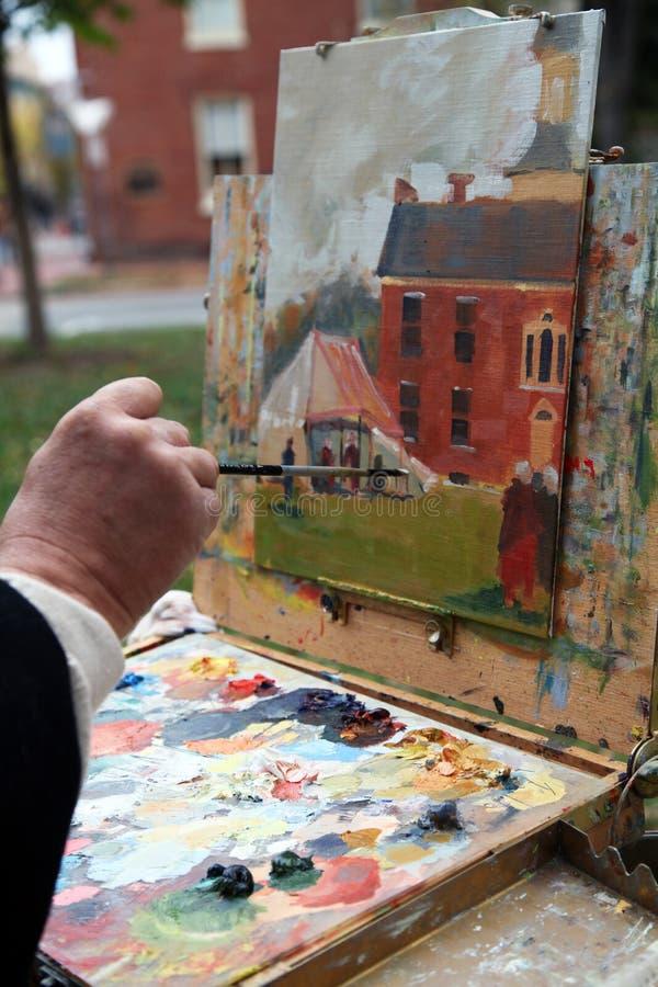 Οι ζωγράφοι δίνουν την εργασία σε μια αποικιακή εικόνα στοκ εικόνα