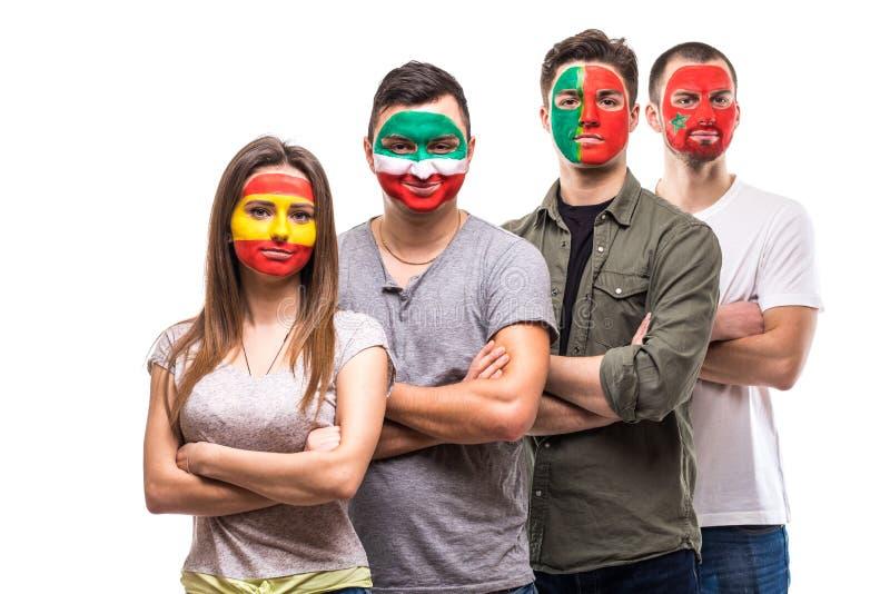 Οι θαυμαστές υποστηρικτών ομάδας ανθρώπων των εθνικών ομάδων χρωμάτισαν το πρόσωπο σημαιών της Πορτογαλίας, Ισπανία, Marocco, Ιρά στοκ εικόνες