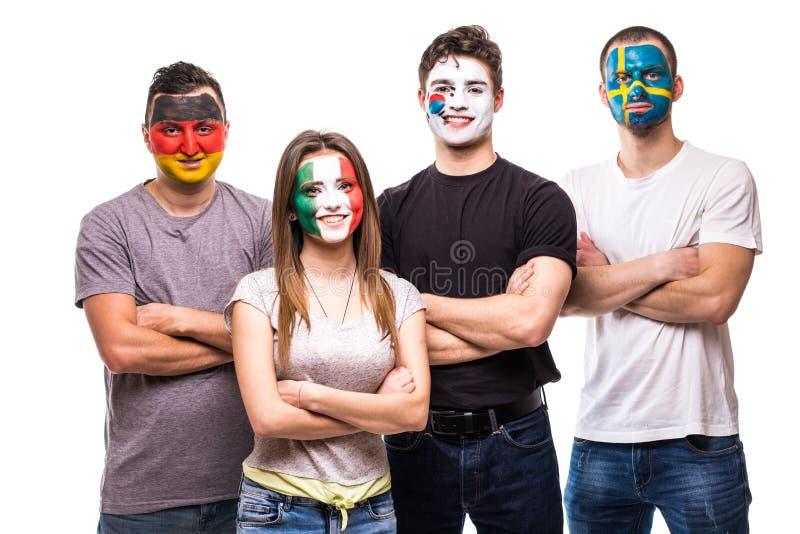 Οι θαυμαστές υποστηρικτών ομάδας ανθρώπων των εθνικών ομάδων χρωμάτισαν το πρόσωπο σημαιών της Γερμανίας, Μεξικό, Δημοκρατία της  στοκ εικόνα
