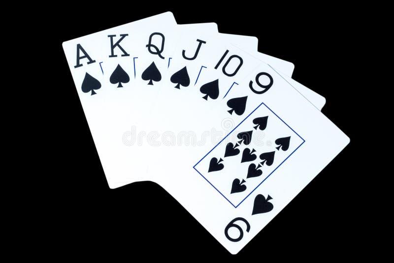 Οι κάρτες παιχνιδιού σε ένα μαύρο υπόβαθρο, έννοια μεγάλου και κερδίζουν στοκ εικόνες