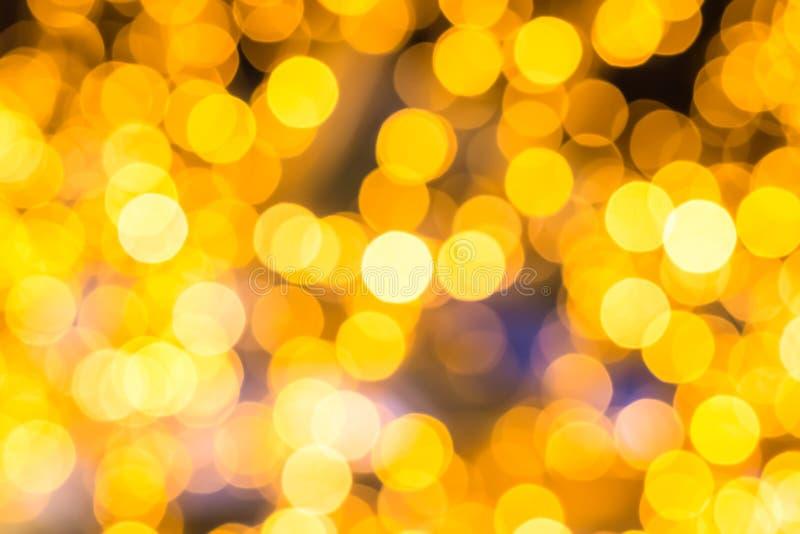 Οι καθορισμένοι χρυσοί κίτρινοι μουτζουρωμένοι κύκλοι της ελαφριάς καθορισμένης κάρτας Χριστουγέννων υποβάθρου διακοσμήσεων υποβά στοκ φωτογραφία με δικαίωμα ελεύθερης χρήσης
