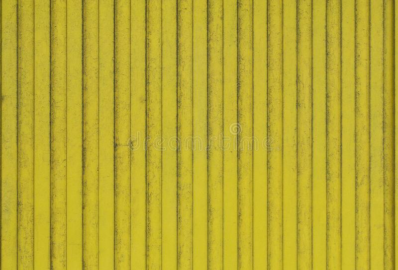 Οι παλαιές σανίδες του ξύλου χρωμάτισαν φωτεινό κίτρινο στοκ εικόνες