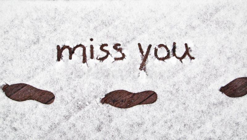 Οι τυπωμένες ύλες χειμερινών παπουτσιών με τη χειρόγραφη δεσποινίδα εσείς χιονίζουν στοκ φωτογραφία με δικαίωμα ελεύθερης χρήσης
