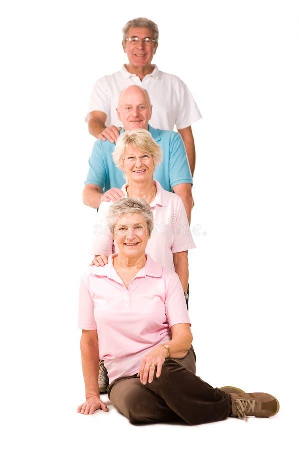 οι φίλοι άσκησης ομαδοπ&om στοκ φωτογραφία με δικαίωμα ελεύθερης χρήσης