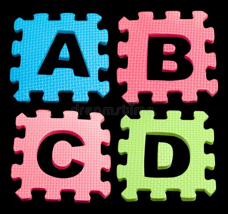 Οι φραγμοί εκμάθησης αλφάβητου ABCD απομόνωσαν το Μαύρο στοκ φωτογραφία