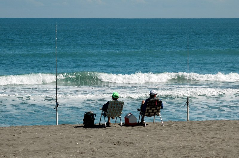 οι ψαράδες κάνουν σερφ στοκ φωτογραφία με δικαίωμα ελεύθερης χρήσης