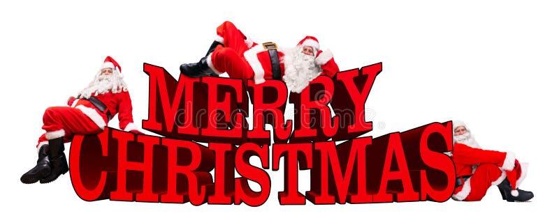 Ομάδα Άγιου Βασίλη με τη Χαρούμενα Χριστούγεννα λέξης απεικόνιση αποθεμάτων
