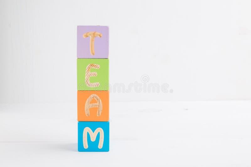 Ομάδα λέξης που γίνεται από τους ξύλινους πολύχρωμους κύβους στοκ εικόνες