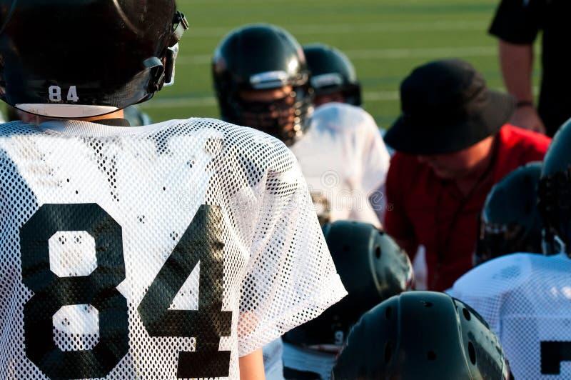 Ομάδα αμερικανικού ποδοσφαίρου στη συσσώρευση στοκ φωτογραφία με δικαίωμα ελεύθερης χρήσης