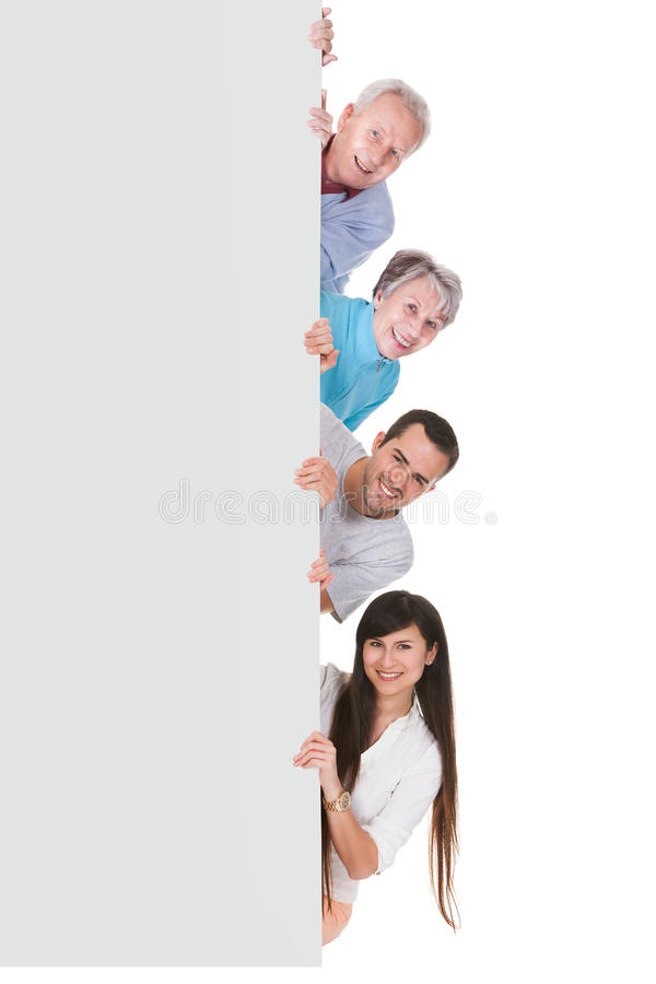 Ομάδα ανθρώπων με την αφίσσα στοκ φωτογραφία με δικαίωμα ελεύθερης χρήσης