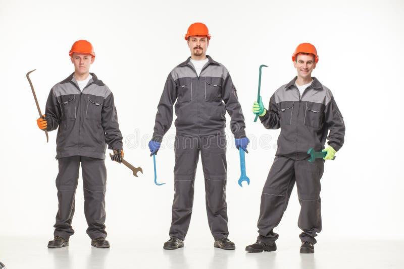 Ομάδα βιομηχανικών εργατών Απομονωμένος πέρα από την άσπρη ανασκόπηση στοκ εικόνες