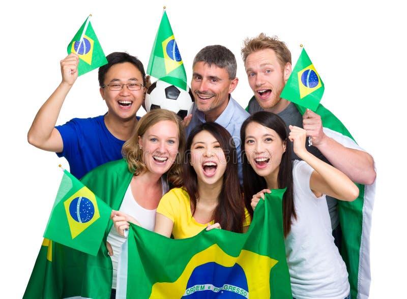 Ομάδα ευτυχούς βραζιλιάνου ανεμιστήρα ποδοσφαίρου στοκ εικόνες