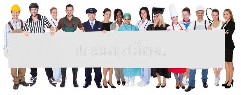 Ομάδα διαφορετικών επαγγελματιών στοκ φωτογραφία
