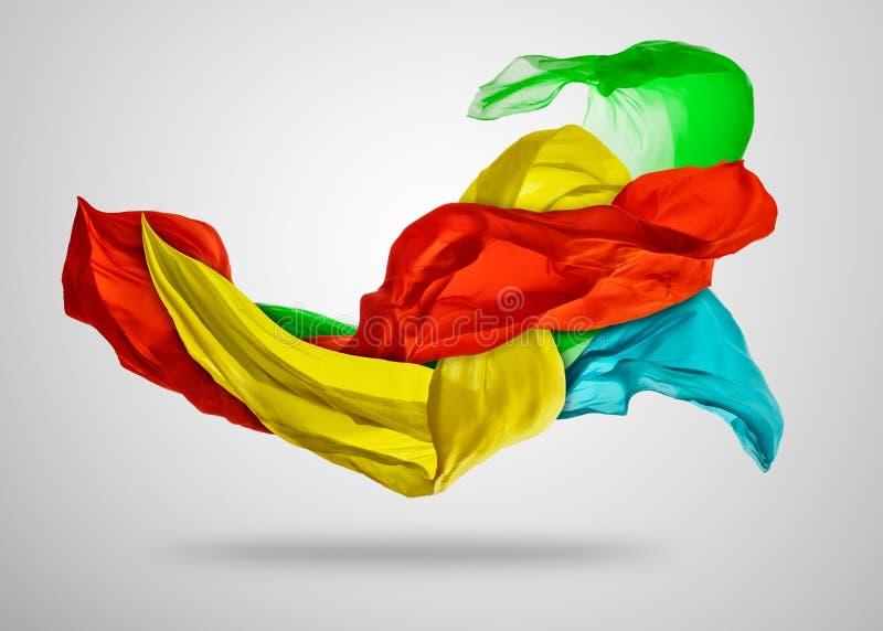 Ομαλό κομψό χρωματισμένο ύφασμα στο γκρίζο υπόβαθρο στοκ φωτογραφία με δικαίωμα ελεύθερης χρήσης