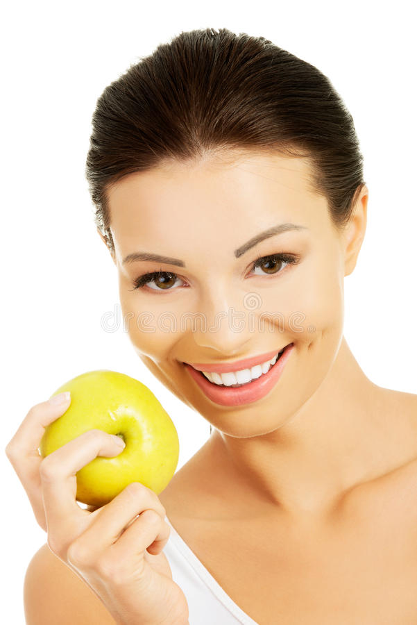 Ομορφιά χαμόγελου που κρατά το πράσινο μήλο στοκ εικόνες