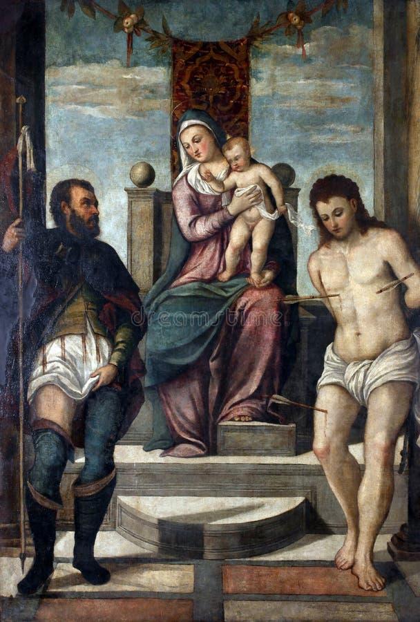 Οπαδός του Tiziano Vecellio: Madonna και παιδί στο θρόνο με το ST Roch και το ST Sebastian στοκ φωτογραφίες με δικαίωμα ελεύθερης χρήσης