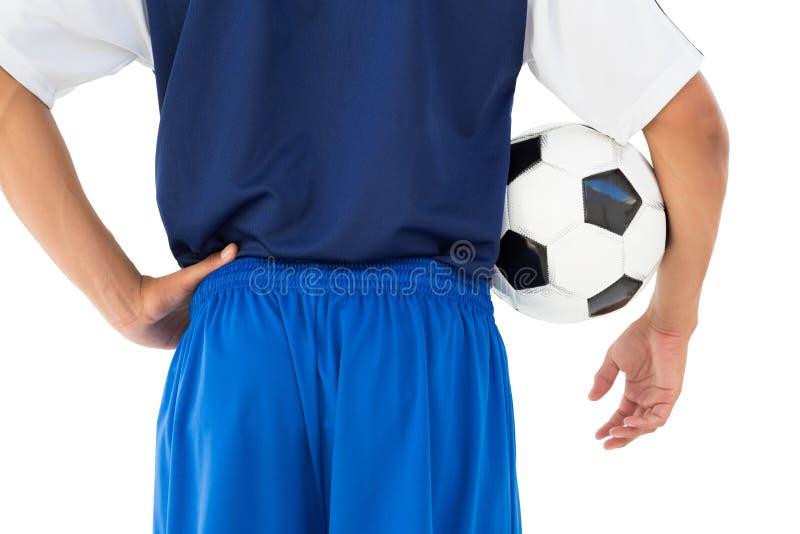 Οπισθοσκόπος μέσος ποδοσφαιριστής τμημάτων στοκ φωτογραφία