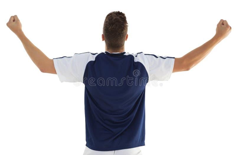 Οπισθοσκόπος του αθλητικού ποδοσφαιριστή ενθαρρυντικού στοκ φωτογραφίες