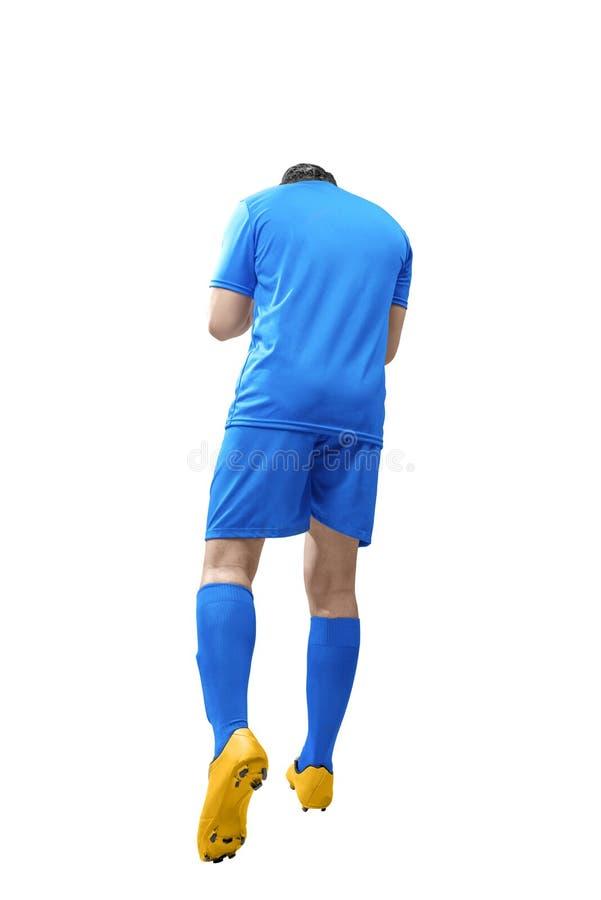 Οπισθοσκόπο του ασιατικού ποδοσφαιριστή το άτομο γιορτάζει το στόχο του στοκ φωτογραφία