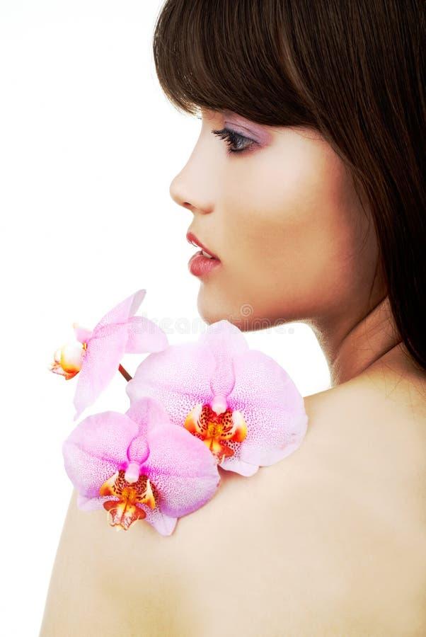 οπλίστε orchid της spa τη γυναίκα στοκ φωτογραφία με δικαίωμα ελεύθερης χρήσης