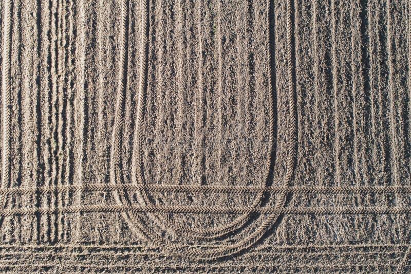 Οργωμένος χωματένιος τομέας, υπόβαθρο ρύπου στοκ εικόνα