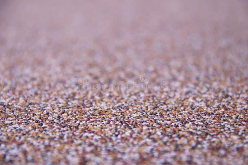 Οριζόντια σύσταση των πολύχρωμων μικρών πετρών και copyspace στοκ εικόνα