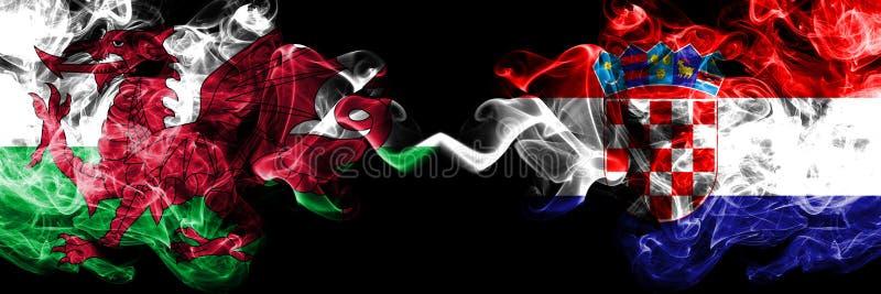 Ουαλία, ουαλλέζικα, Κροατία, κροατικές ζωηρόχρωμες καπνώείς σημαίες ανταγωνισμού πυκνά Ευρωπαϊκοί αγώνες προσόντων ποδοσφαίρου στοκ φωτογραφία