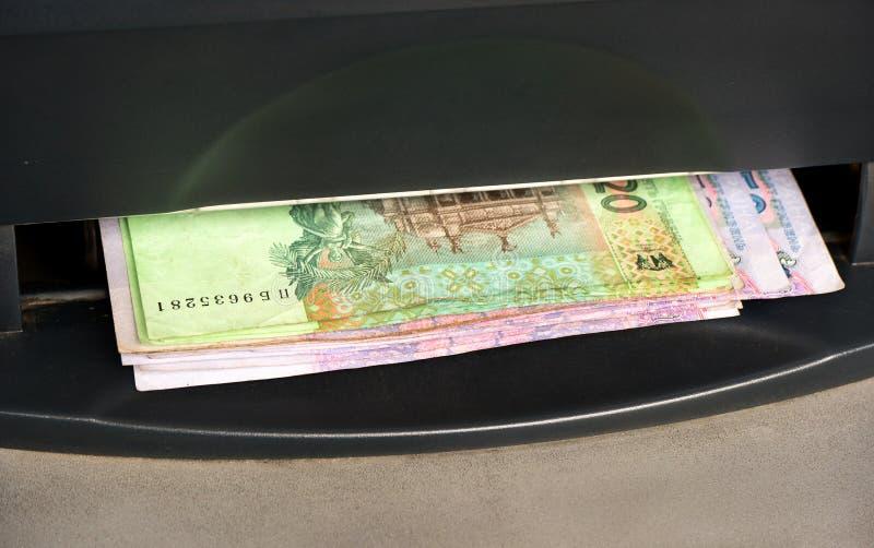 Ουκρανικά χρήματα από το ATM στοκ εικόνα
