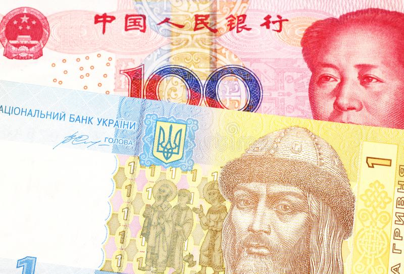 Ουκρανικός hryvnia με μια κινεζική yuan σημείωση στοκ φωτογραφίες με δικαίωμα ελεύθερης χρήσης