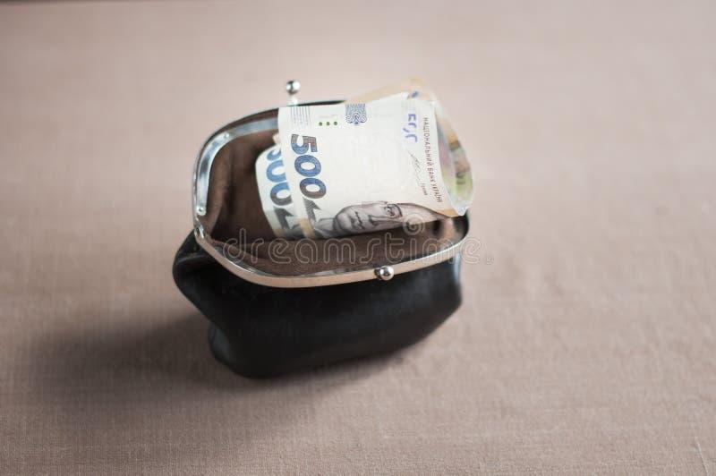 Ουκρανικό hryvnia σε ένα εκλεκτής ποιότητας καφετί πορτοφόλι στοκ φωτογραφία με δικαίωμα ελεύθερης χρήσης
