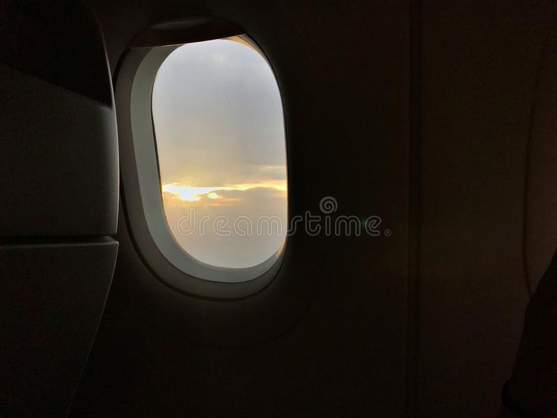 Ουρανός βραδιού και κάθισμα αεροπλάνων στοκ φωτογραφία