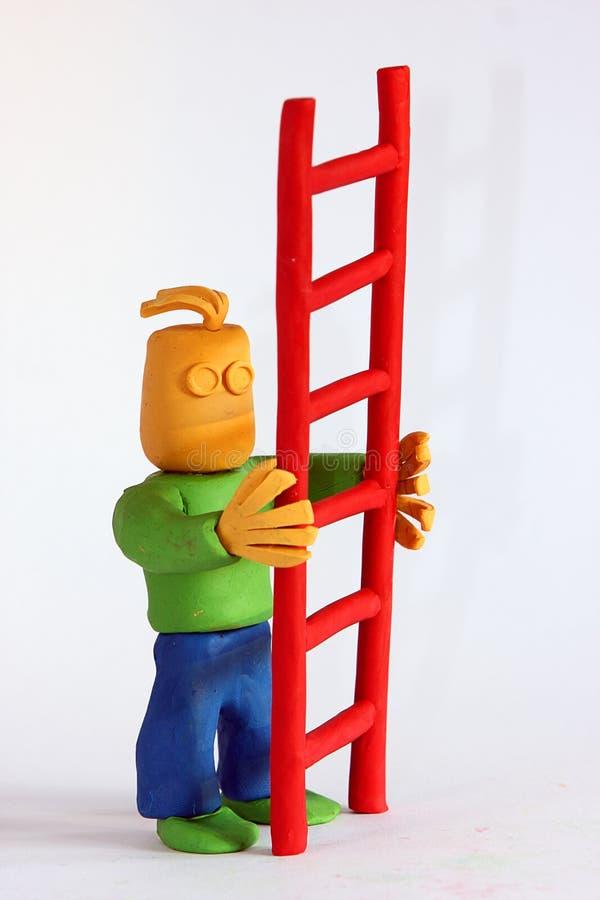 ο άργιλος κρατά το άτομο &sigm στοκ εικόνα με δικαίωμα ελεύθερης χρήσης
