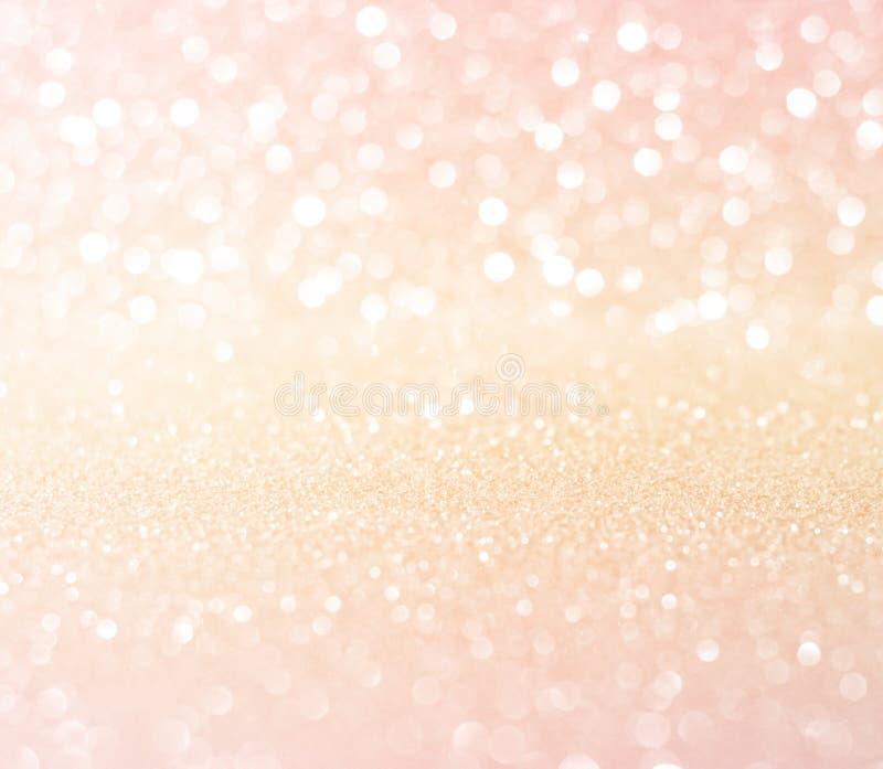 Ο άσπρος ρόδινος χρυσός ακτινοβολεί bokeh αφηρημένο backgro Χριστουγέννων σύστασης στοκ εικόνα