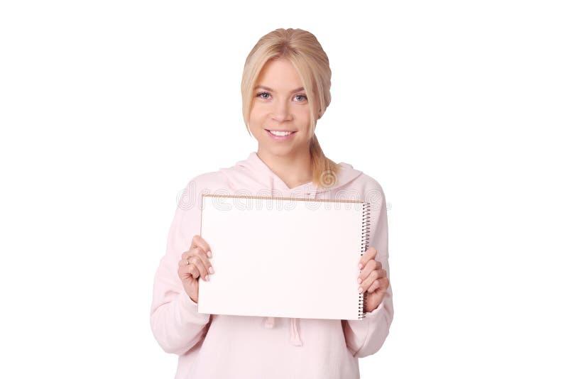 Ο απομονωμένος σπουδαστής κρατά ένα σημάδι στοκ εικόνα