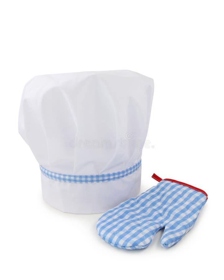 ο αρχιμάγειρας φορά γάντια στο καπέλο στοκ εικόνες