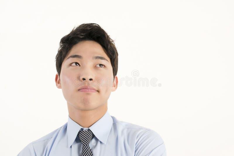 Ο ασιατικός επιχειρηματίας ανησυχεί κάτι στοκ εικόνα