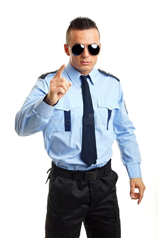 Ο αστυνομικός παρουσιάζει σε σας στοκ φωτογραφίες με δικαίωμα ελεύθερης χρήσης