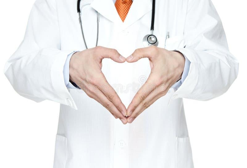 ο γιατρός δίνει στην καρδιά την αρσενική μορφή του s στοκ φωτογραφία με δικαίωμα ελεύθερης χρήσης